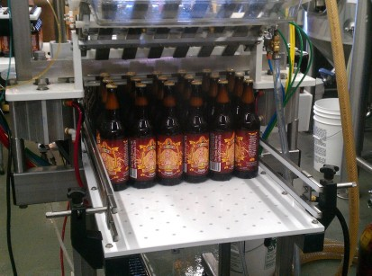 Dry Dock Apricot Blonde in the bottling line.